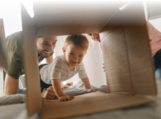 Family playing in moving box