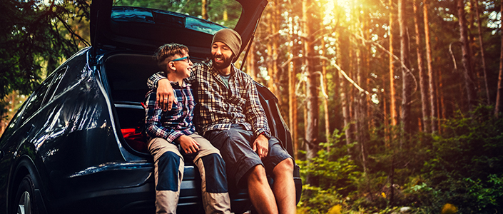Father and son enjoy camping with a new car