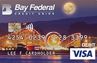 A debit card with an image of the Boardwalk at night