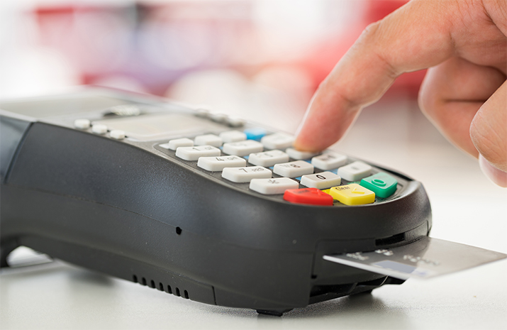 Person enters PIN into card reader