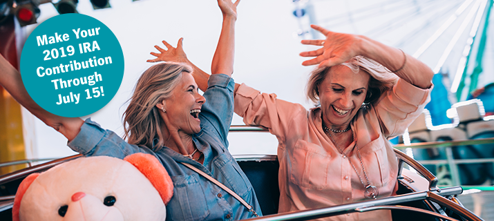 Two women having fun on a carnival ride