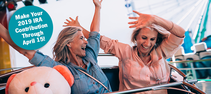 Two women laughing on carnival ride